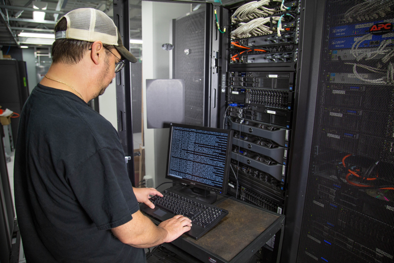 technician monitoring network infrastructure